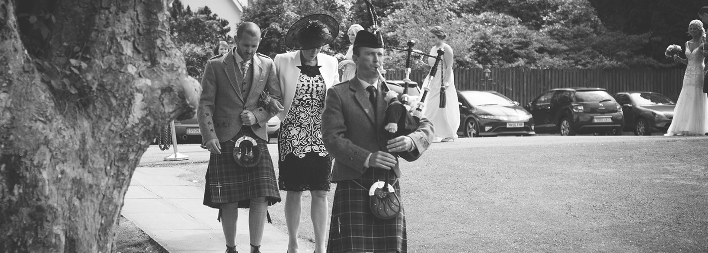 Wedding piper keith piping at Loch Lomond