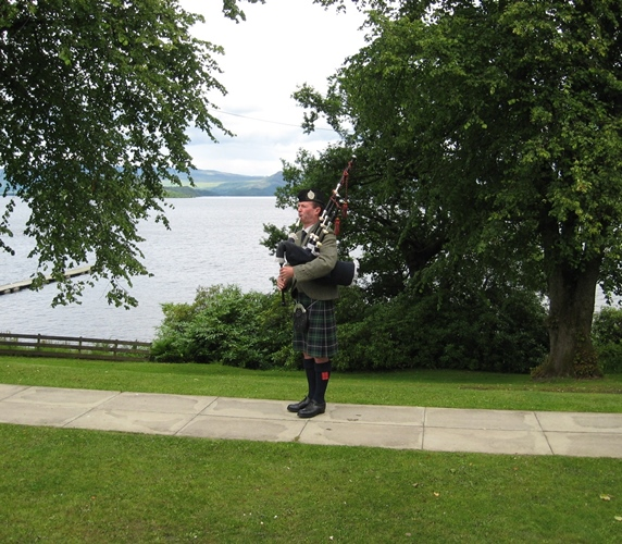 Solo piper playing at the Cruin on Loch Lomond
