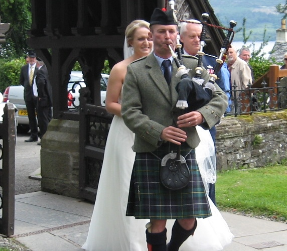 Keith piping at wedding in Luss Church near Loch Lomond