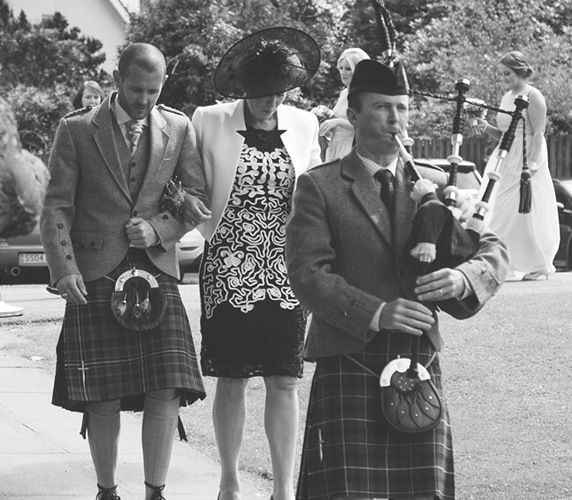Scottish piper playing at a wedding